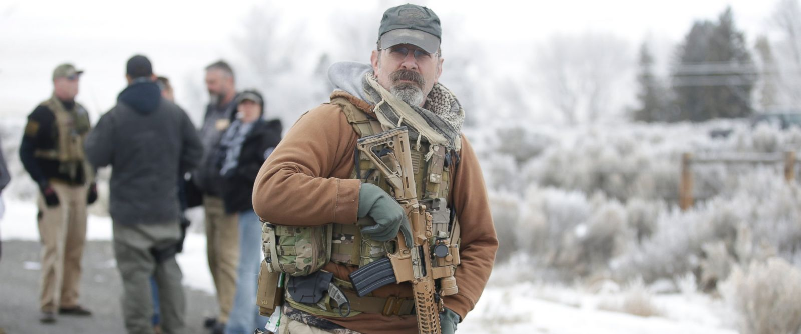 "PHOTO: A man stands guard after members of the ""3% of Idaho"" group along with several other organizations arrived at the Malheur National Wildlife Refuge near Burns, Ore., on Saturday, Jan. 9, 2016."