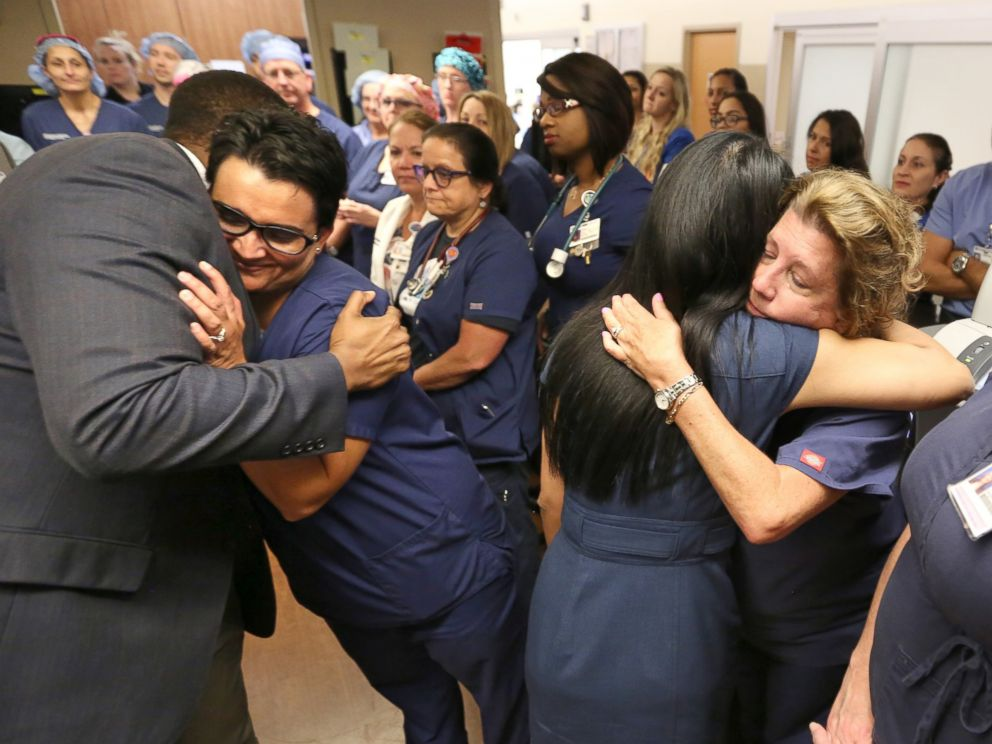 PHOTO: Doctors, nurses and first-responders hug after a brief prayer service in the emergency room at Florida Hospital in Orlando, Fla., June 15, 2016, to honor the victims of the Pulse nightclub mass shooting.
