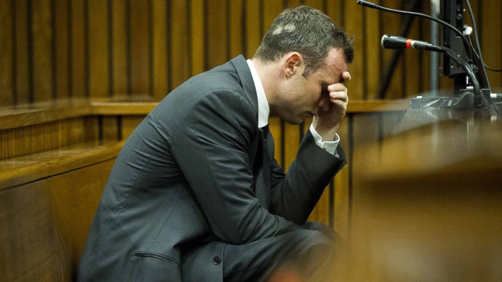 PHOTO: Oscar Pistorius puts his hand to his head while listening to cross questioning about th