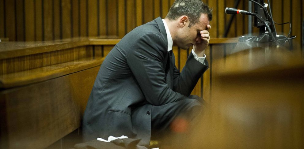 PHOTO: Oscar Pistorius puts his hand to his head while listening to cross questioning about the events surrounding the shooting death of his girlfriend Reeva Steenkamp