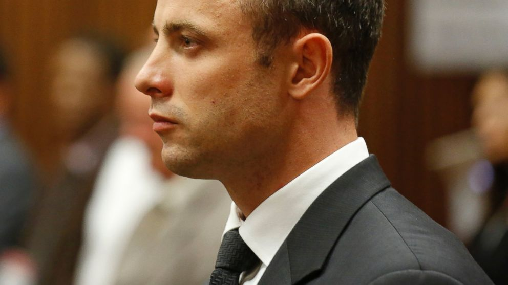 PHOTO: Oscar Pistorius listens to cross questioning in court during his trial at the high court in Pretoria, South Africa, March 7, 2014.