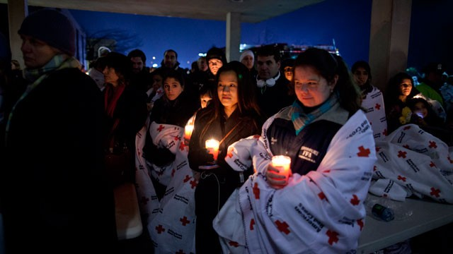 PHOTO: Residents hold a candlelight vigil outside Newtown High School after President Barack Obama delivered remarks at an interfaith vigil for the victims of the Sandy Hook Elementary School shooting on Dec. 16, 2012, at Newtown High School in Newtown, C