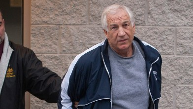 PHOTO: Former Penn State assistant football coach Jerry Sandusky, right, leaves the office of Centre County District Justice Daniel A. Hoffman under escort by Pennsylvania State Police and Attorney General's Office officials, Bellefonte, Pa., Dec. 7, 2011