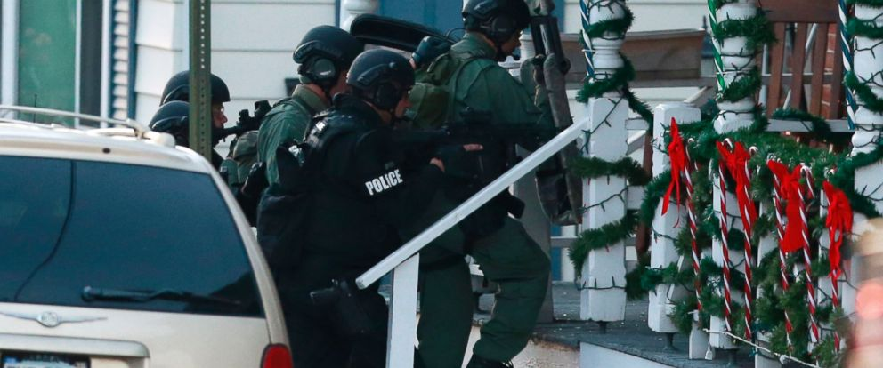 PHOTO: Police gather near a home, Dec. 15, 2014, in Pennsburg, Pa., where suspect Bradley William Stone is believed to have barricaded himself inside after shootings at multiple homes.