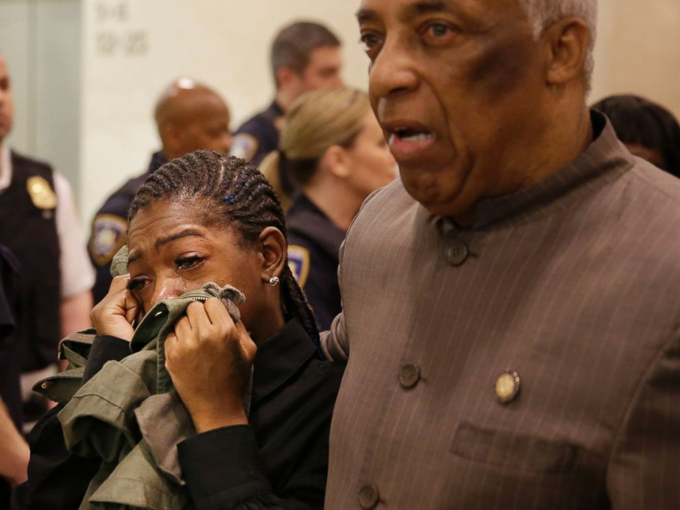 PHOTO: Melissa Butler, Akai Gurleys girlfriend, cries as she is escorted out of the courtroom by Assemblyman Charles Barron in New York, Tuesday, April 19, 2016.