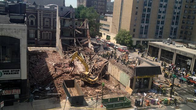 PHOTO: Emergency personnel respond to a building collapse in downtown Philadelphia, where the city fire commissioner says as many as eight to 10 people are believed trapped in the rubble, June 5, 2013.