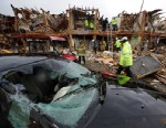 PHOTO: A smashed car sits in front of an apartment complex destroyed by an explosion at a fertilizer plant in West, Texas, as firefighters conduct a search and rescue, April 18, 2013. A massive explosion at the West Fertilizer Co. Wednesday night killed a