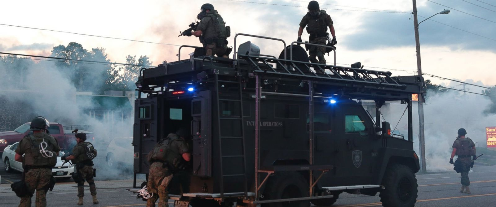 PHOTO: Tactical officers fire tear gas on Monday, Aug. 11, 2014, in Ferguson, Mo.