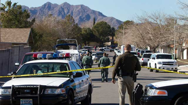 PHOTO: Law enforcement officials investigate a shooting and fire in Boulder City, Nev., Jan. 21, 2013.