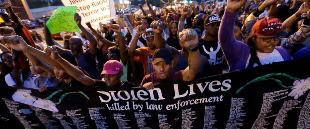 PHOTO: People protest the police shooting death of Michael Brown a week ago in Ferguson, Mo., Saturday, Aug. 16, 2014.