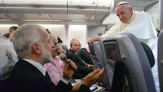 PHOTO:Pope Francis on the airplane addressing press