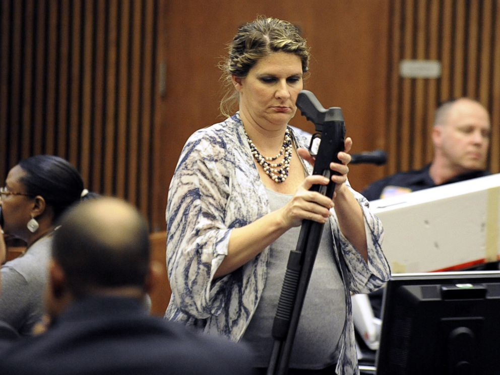 PHOTO: Wayne County Assistant Prosecutor Danielle Hagaman-Clark holds the gun used to kill Renisha McBride during the Theodore Wafer trial in Detroit on July 24, 2014.