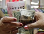 PHOTO: A customer buys three Powerball tickets at a local supermarket in Hialeah, Fla.,Tuesday, Nov. 27, 2012.