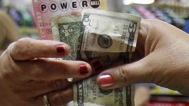 PHOTO:&nbsp;A customer buys three Powerball tickets at a local supermarket in Hialeah, Fla.,Tuesday, Nov. 27, 2012.