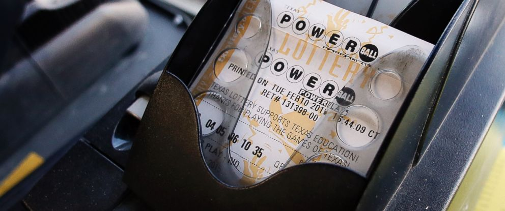 PHOTO: A Powerball ticket sits in the tray dispenser after being printed out for a customer at Fuel City, Feb. 10, 2015, in Dallas.
