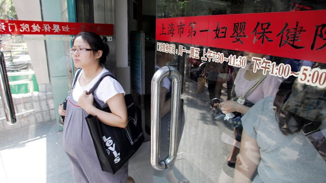 PHOTO: A pregnant Chinese woman walks out of the Shanghai First Maternity and Infant Health Hospital in Shanghai, China, Aug. 24 2010. Chinese women of influence and affluence are coming to the U.S. to give birth so that their offspring will be American c