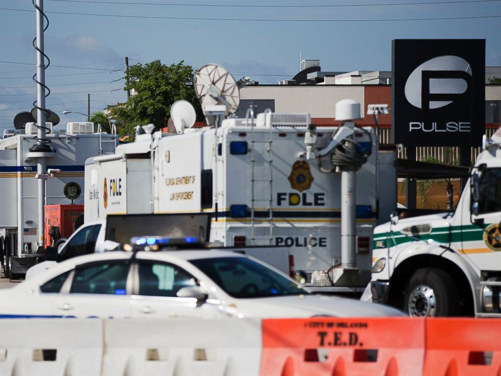PHOTO: Law enforcement mobile command vehicles line the street next to the scene of the Pulse nightclub mass shooting, June 16, 2016, in Orlando, Florida.