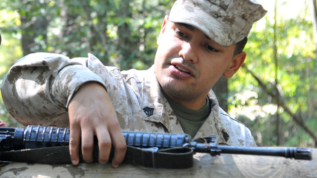 PHOTO: This undated image provided by the U.S. Marine Corps shows Sgt. Eusebio Lopez, an Officer Candidate School instructor, during the Quantico Leadership Venture at OCS on Se