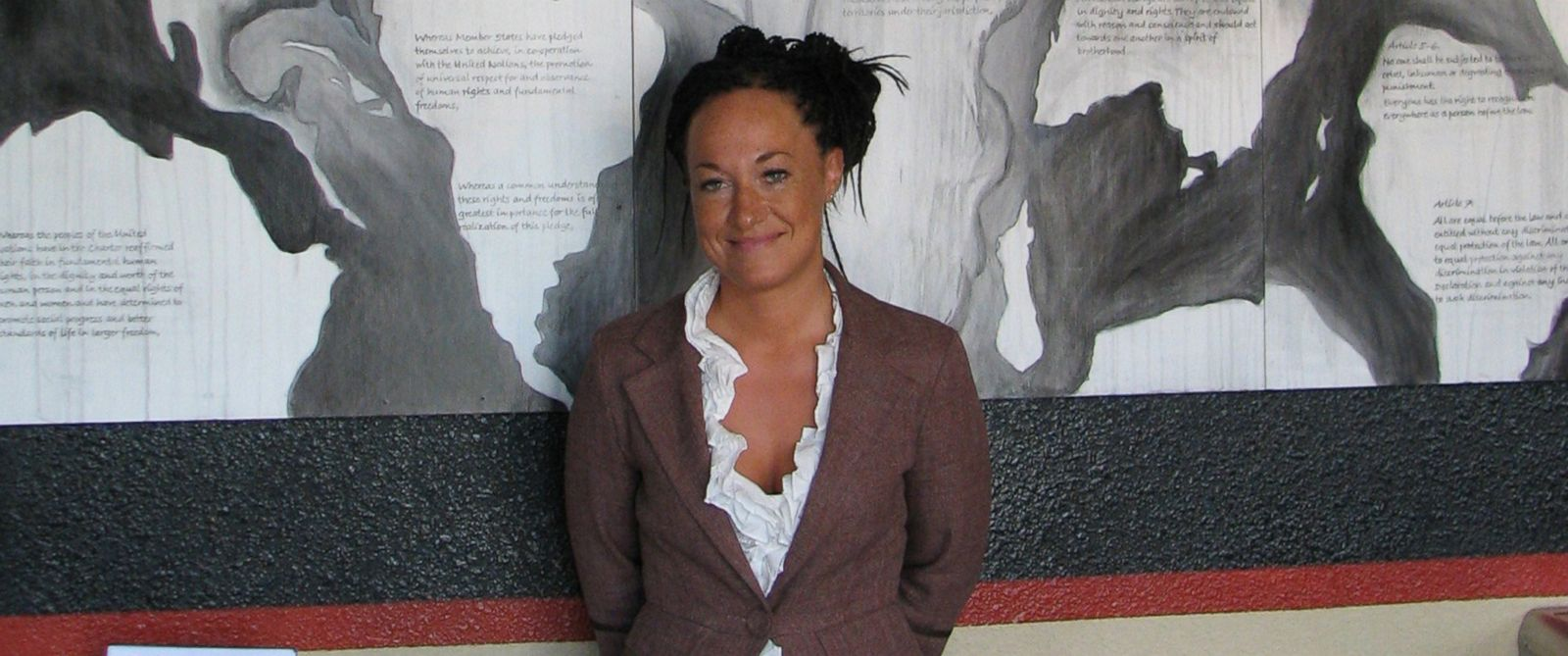 PHOTO: In this July 24, 2009, file photo, Rachel Dolezal, a leader of the Human Rights Education Institute, stands in front of a mural she painted at the institutes offices in Coeur dAlene, Idaho.