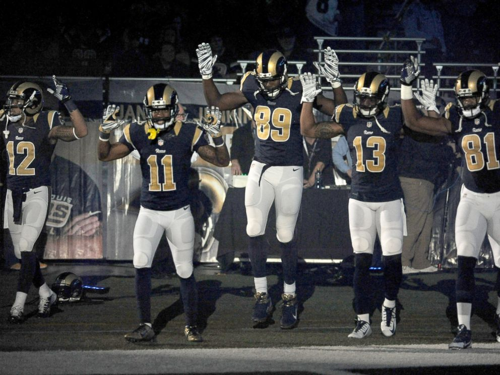 PHOTO: In this Sunday Nov. 30, 2014, file photo, St. Louis Rams players raise their arms in awareness of the events in Ferguson, Mo., as they walk onto the field during introductions before an NFL football game against the Oakland Raiders in St. Louis.