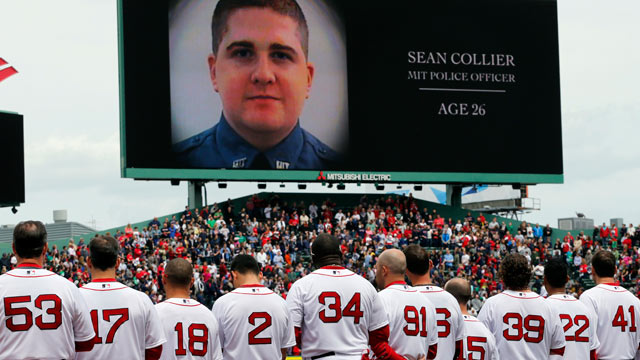 PHOTO: The Boston Red Sox line up during a tribute to victims of the Boston Marathon