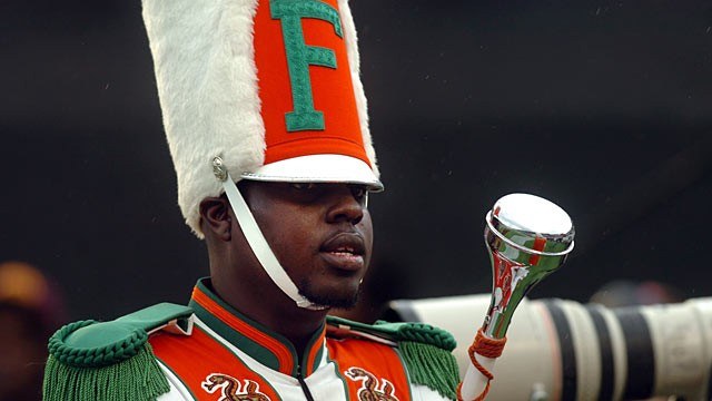 PHOTO: Robert Champion, a drum major in Florida A&M University's Marching 100 band, performs during halftime of a football game in Orlando, Fla.