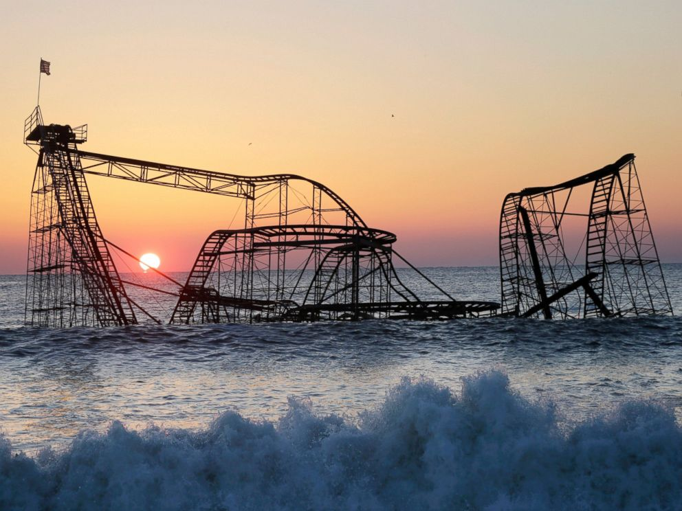 PHOTO: The sun rises in Seaside Heights, N.J., Feb. 25, 2013, behind the Jet Star Roller Coaster which was sitting in the ocean after part of the Funtown Pier was destroyed during Superstorm Sandy.