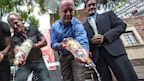 PHOTO: Michael Niemeyer, Matthew Ervin, Alfredo Diaz, Richard Grossi, Rodney Scott and council member John Duran empty Russian vodka bottles into a gutter during a news conference on Aug. 1, 2013 in West Hollywood, Calif.