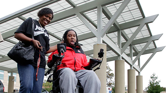 PHOTO: Paralyzed Rutgers football player Eric LeGrand, right, and his mother, Karen LeGrand, leave the Kessler Institute for Rehabilitation in West Orange, N.J., Oct. 12, 2011.