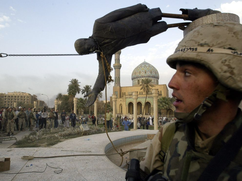 PHOTO: The April 9, 2003 file photo shows Iraqi civilians and U.S. soldiers pulling down a statue of Saddam Hussein in downtown Baghdad.