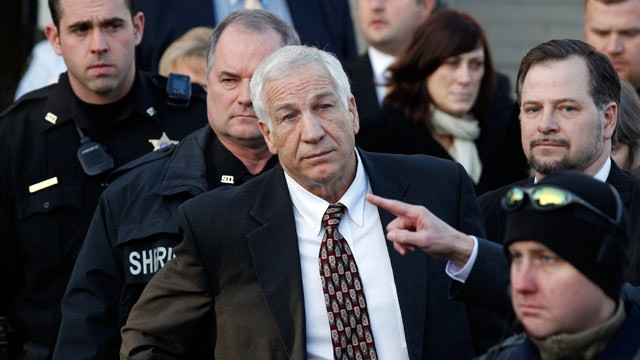 PHOTO: This Dec. 13, 2011 file photo shows Jerry Sandusky, center, a former Penn State assistant football coach charged with sexually abusing boys, pausing as his attorney Joe Amendola makes a point as they depart the Centre County Courthouse in Bellefont