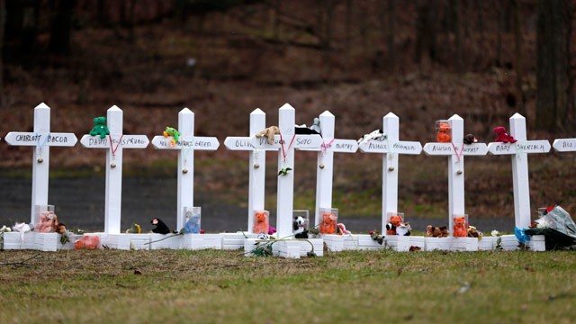 PHOTO: Crosses bearing the names of the Newtown shooting victims are displayed in the Sandy Hook village of Newtown, Conn., Saturday, Dec. 22, 2012.