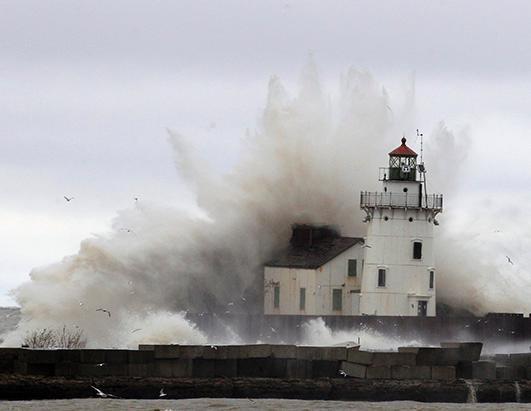 Hurricane waves hitting lighthouse