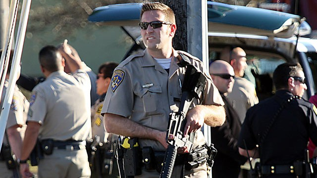 PHOTO: A California Highway Patrol officer carries his rifle near the shooting scene in Santa Cruz, Calif., where two Santa Cruz Police detectives were shot and killed, Feb. 26, 2013.