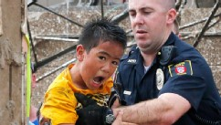 PHOTO: A boy is pulled from beneath a collapsed wall at the Plaza Towers Elementary School following a tornado in Moore, Okla., May 20, 2013.