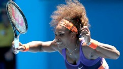 PHOTO: Serena Williams hits forehand return to compatriot Sloane Stephens during their quarterfinal match at the Australian Open tennis championship in Melbourne, Australia, Jan. 23, 2013.