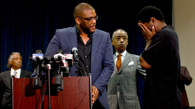 PHOTO: Filmmaker Tyler Perry, left, and the Rev. Al Sharpton, center, look on as an unidentified man comes forward during a news conference to discuss the special missing-person investigations of Terrance Williams and Fe