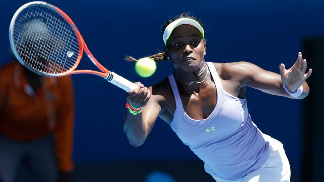PHOTO: Sloane Stephens of the US hits a forehand return to compatriot Serena Williams during their quarterfinal match at the Australian Open tennis championship in Melbourne, Australia on Jan. 23, 2013.