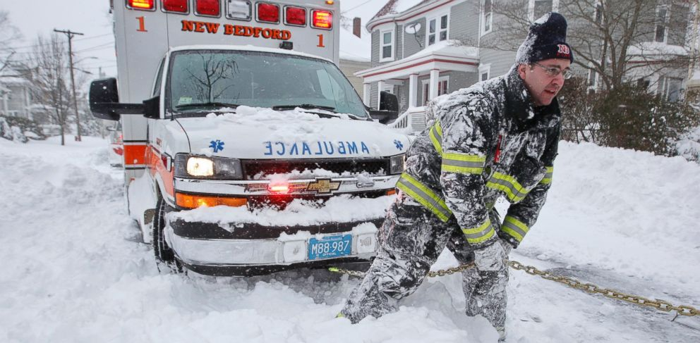 PHOTO: New Bedford firefighter Lt. Eric Hartford tries to dig out an ambulance carrying a patient en route to St. Lukes Hospital in New Bedford, Mass., Jan. 27, 2015, as the region digs itself out of the snow storm that covered the area.