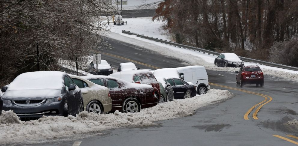 PHOTO: Abandoned vehicles line a roadside following a snow and ice storm in Chapel Hill, N.C., Feb. 13, 2014.
