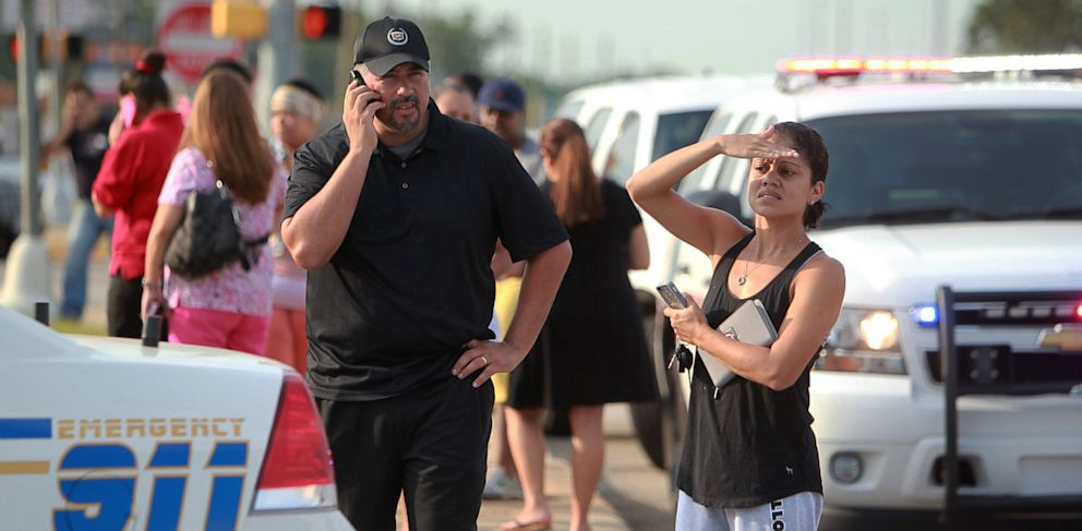 PHOTO: Adults wait outside Spring High School after a stabbing during a fight involving multiple students inside the school on Sept. 4, 2013 in Spring, Texas.