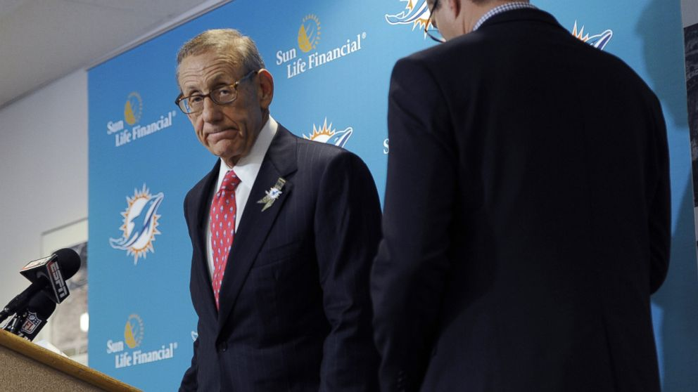 PHOTO: Miami Dolphins owner Stephen Ross, left, and CEO Tom Garfinkel cross paths as they address the media before an NFL football game against the Tampa Bay Buccaneers, Nov. 11, 2013, in T