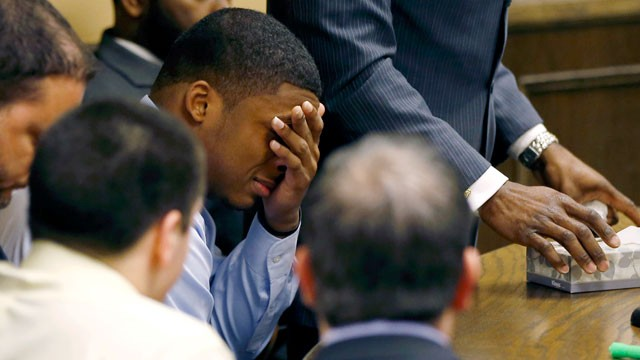 PHOTO: Ma'Lik Richmond covers his eyes and cries as his attorney Walter Madison, standing, asks the court for leniency after Richmond and co-defendant Trent Mays, lower left, were found delinquent on rape and other charges after their trial in juvenile co