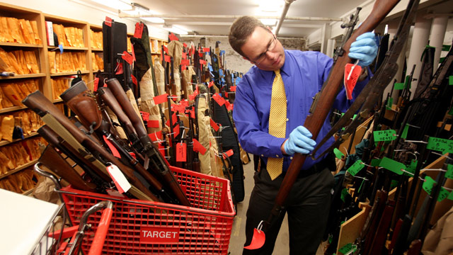 PHOTO: Minneapolis Police Sgt. William Palmer examines one of thousands of guns stored at a secure facility in Minneapolis, Jan. 12, 2011.