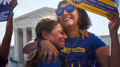 PHOTO: Two women hug as they celebrate during a rally at the Supreme Court in Washington, June 27, 2016, after the court struck down Texas regulation of abortion clinics.