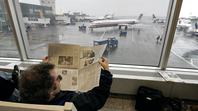 PHOTO: Passenger waits for flight at LaGuardia Airport