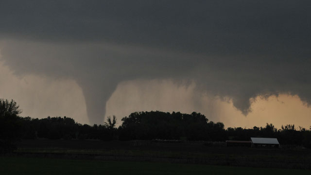 PHOTO: A tornado moves on the ground north of Solomon, Kan., on Saturday evening, April 14, 2012, with I-70 seen in the foreground.