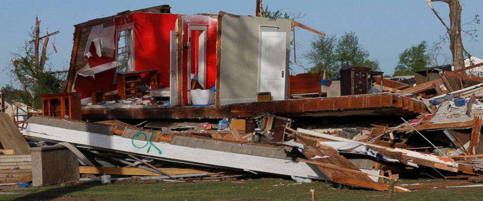 PHOTO: The remains of a home damaged by a tornado Sunday evening stands in Baxter Springs, Kan., April 28, 2014.