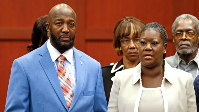 PHOTO: Tracy Martin, left, and Sybrina Fulton, parents of slain teen Trayvon Martin, speak in a news conference prior to opening arguments in the trial of George Zimmerman at the Seminole County Courthouse, June 24, 2013, in Sanford, Fla.