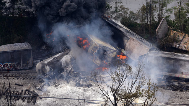 PHOTO: A fire burns at the site of a CSX freight train derailment, May 28, 2013, in White Marsh, Md., where fire officials say the train crashed into a trash truck, causing an explosion that rattled homes at least a half-mile away and collapsed nearby bui